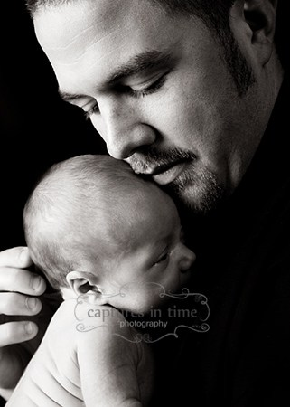Kansas City Newborn Photographer newborn and dad profile black backdrop