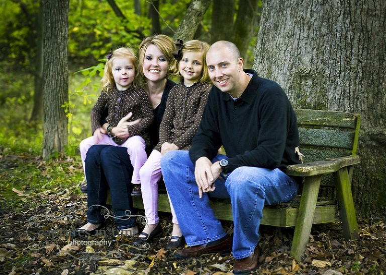 family on bench by tree
