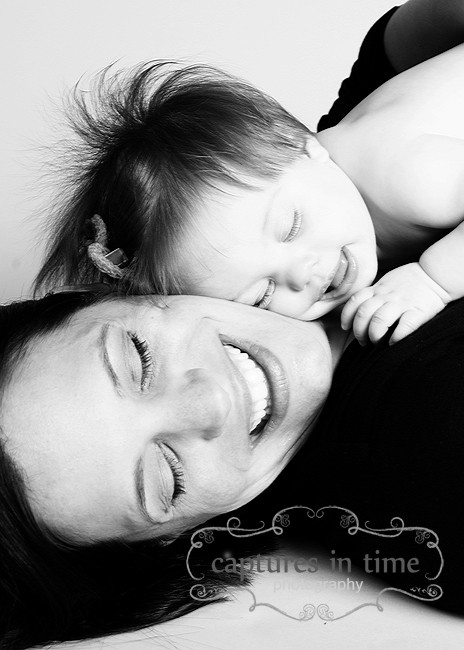 baby cuddling her mom kansas city black and white