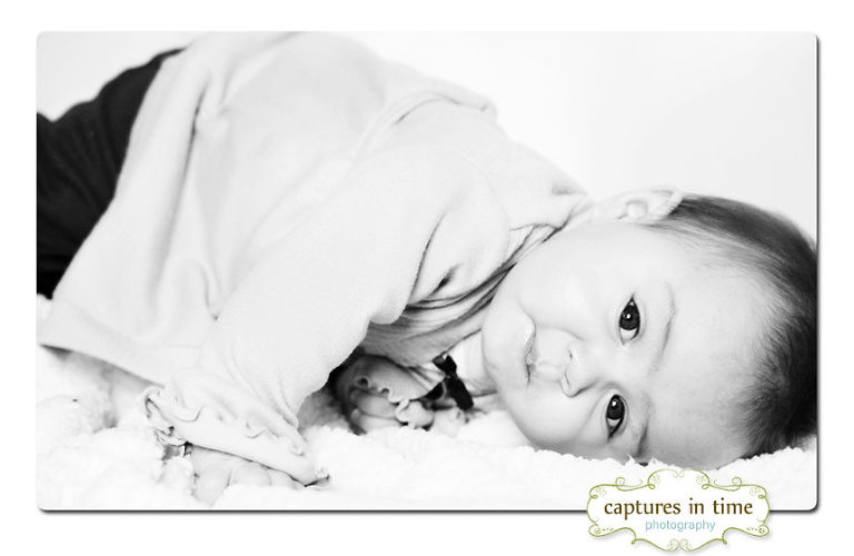 Kansas City Photographer sweet baby girl looking at camera