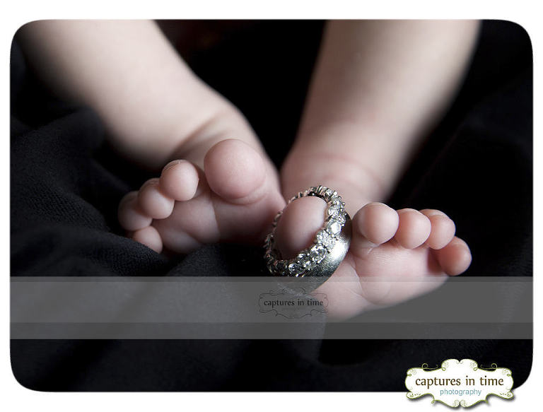 newborn feet with rings on toes