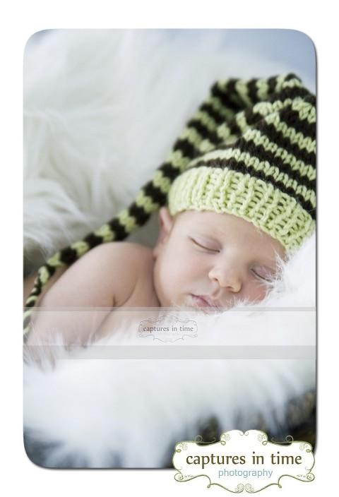 baby in elf hat