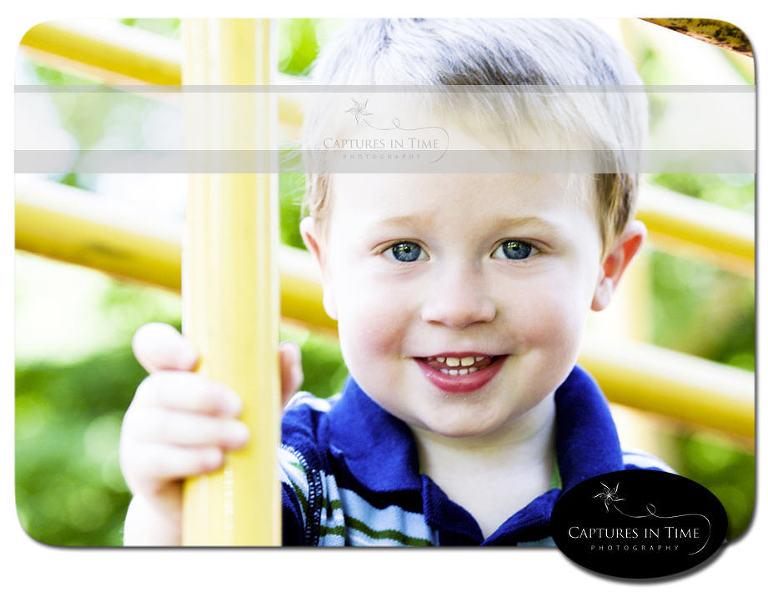 Kansas City Child Photographer boy on a playground