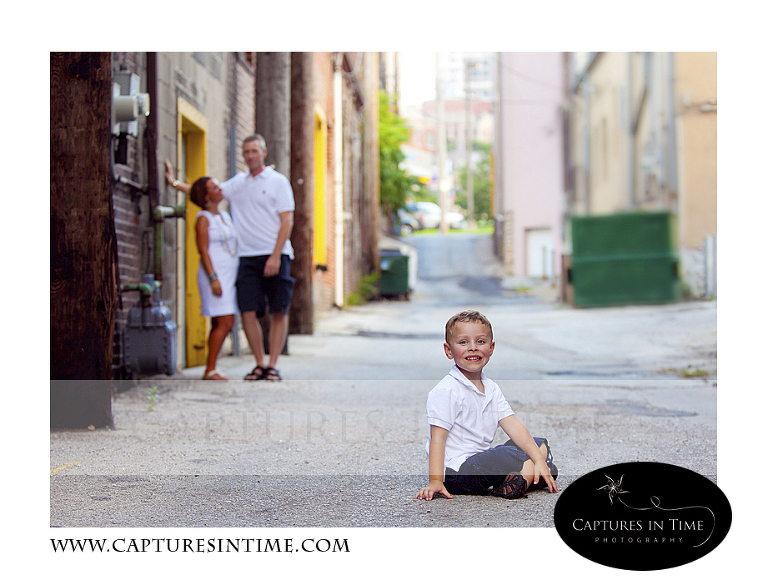 toddler boy sitting in alley River Market