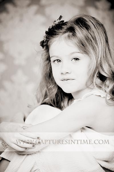 Kansas City Child Photographer sepia girl on damask backdrop