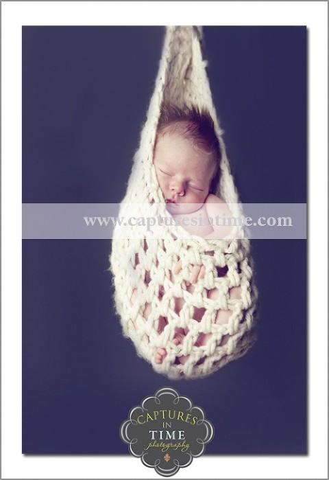 Kansas City Newborn Photographer baby in hanging basket