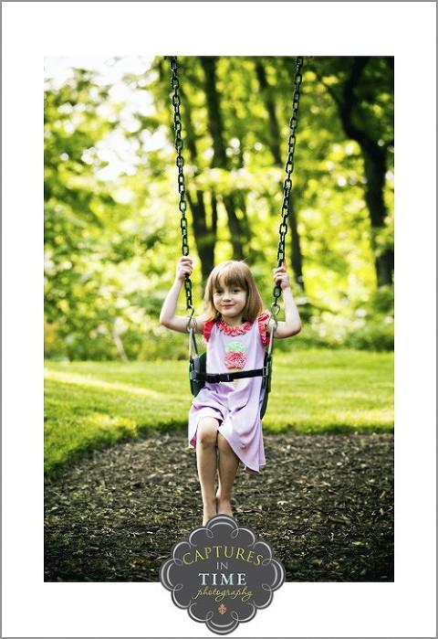 North Kansas City Child Photographer girl on a swing