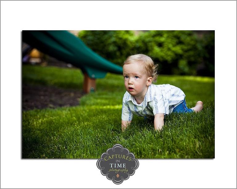 North Kansas City Child Photographer boy crawling in grass