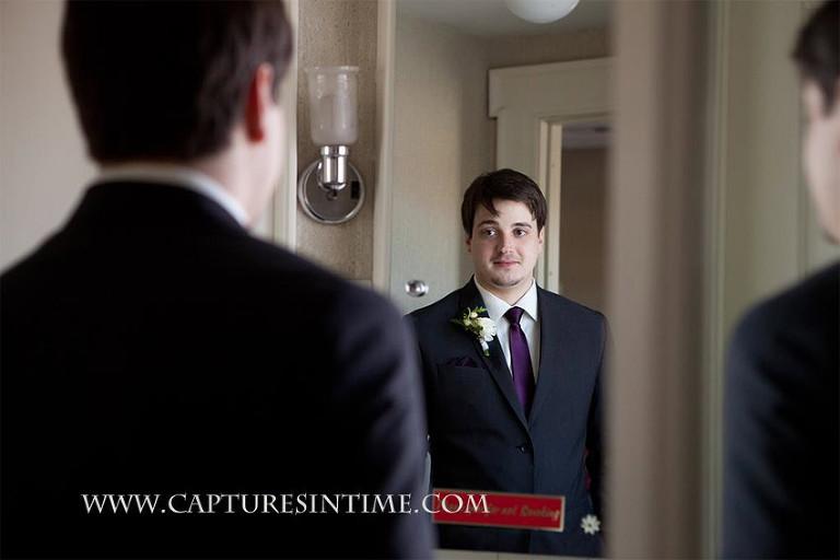 Simpson House Kansas City groom looking in mirror
