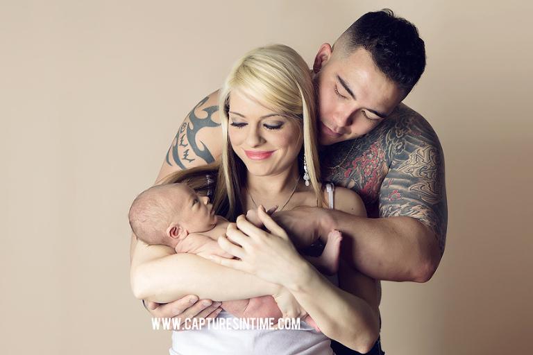 tattoo dad with mom holding newborn