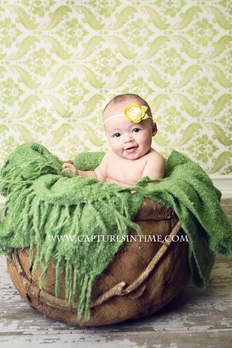 baby sitting up in basket Kansas City