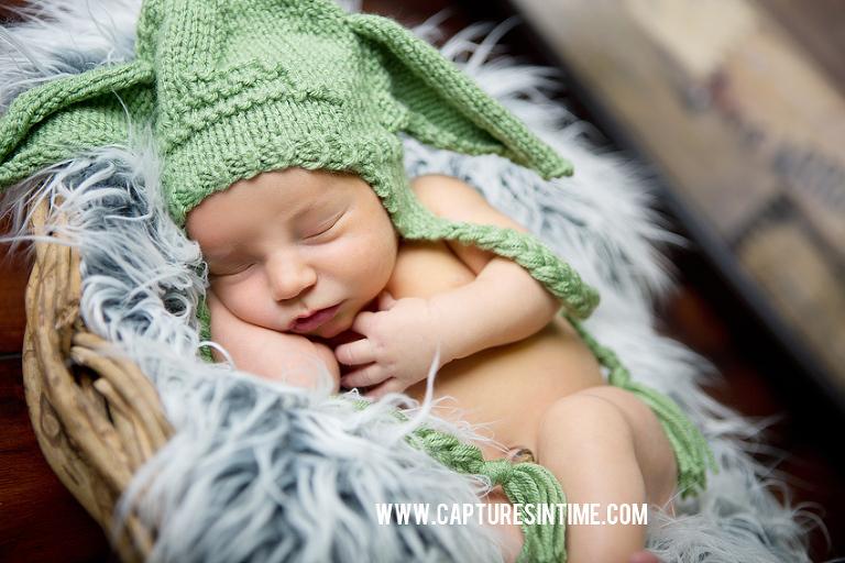 newborn boy sleeping with yoda hat