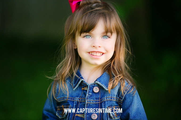 burr oakds girl with pink bow and denim smiling