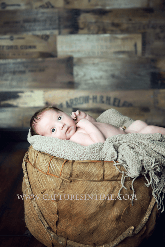 Kansas City newborn in rustic setting