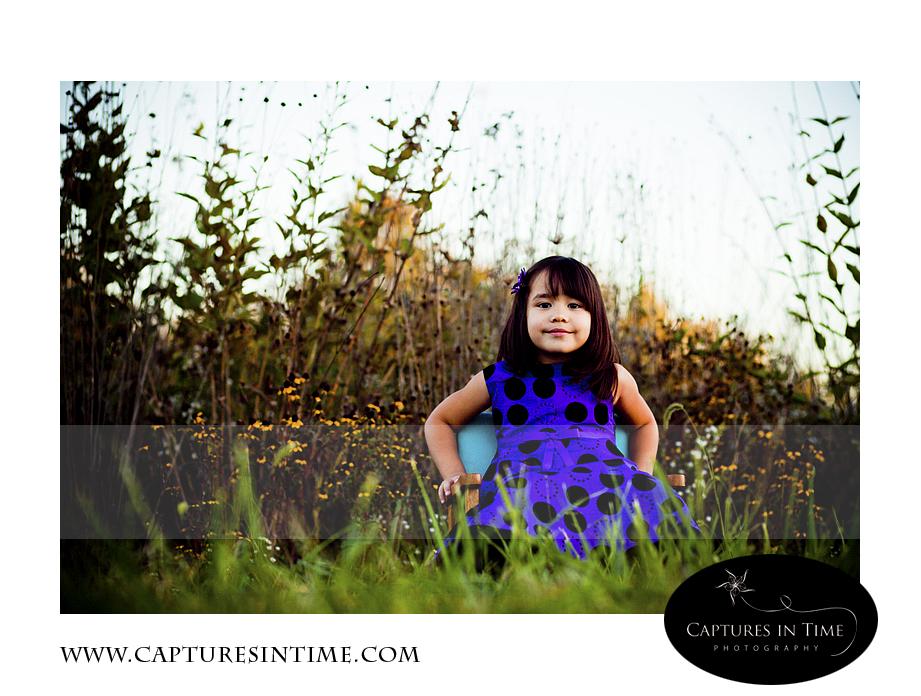 girl on chair in grass burr oak