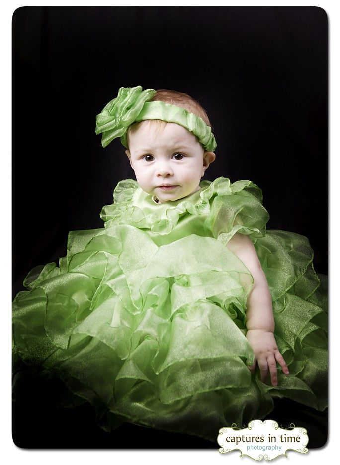 six month old girl in green dress