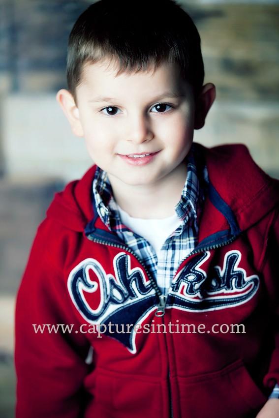 Oshkosh hoodie on boy with plaid shirt