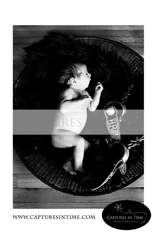 Kansas City Newborn Pics newborn with antique stirrups