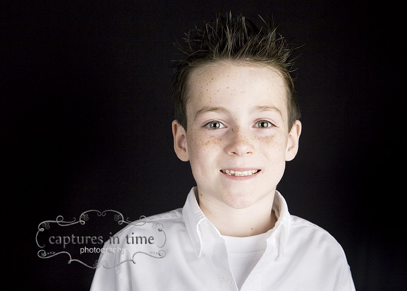 boy with spiky hair in white shirt