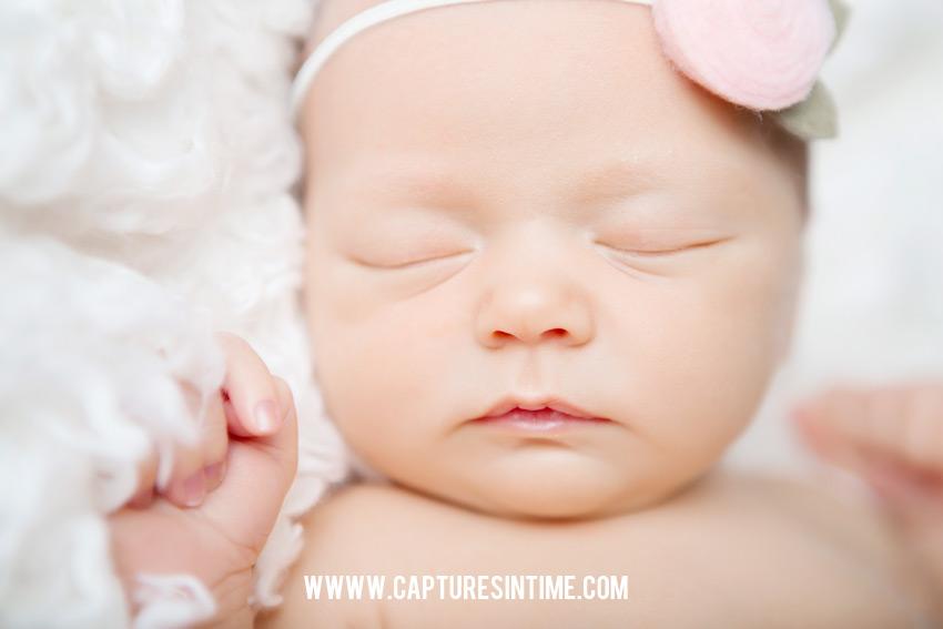 newborn girl close up blue springs