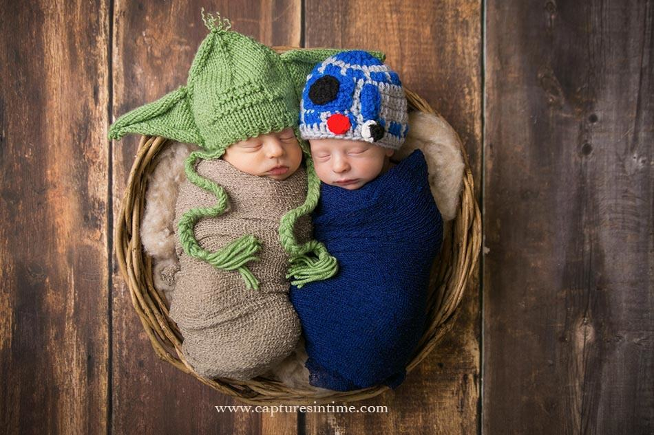 Newborn twins snuggled Yoda and C3PO