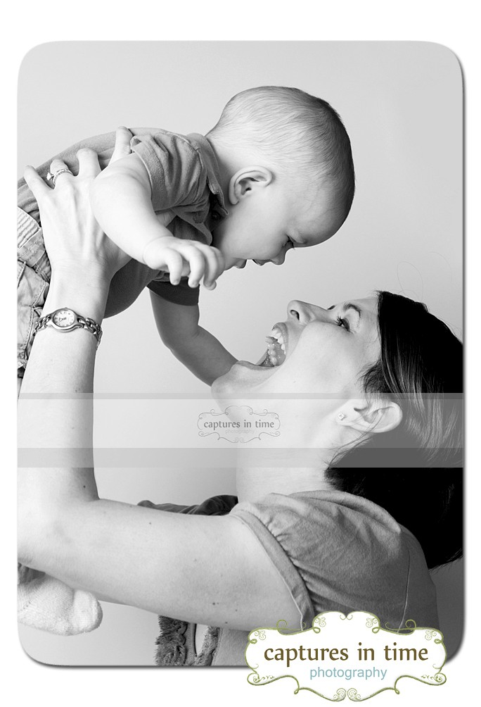 Kansas City Baby Photographer mom laughing with baby black and white