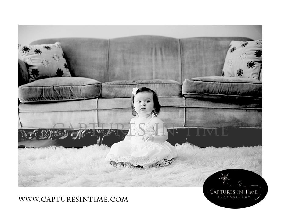 Adorableness Kansas City Photographer one year old in front of vintage couch
