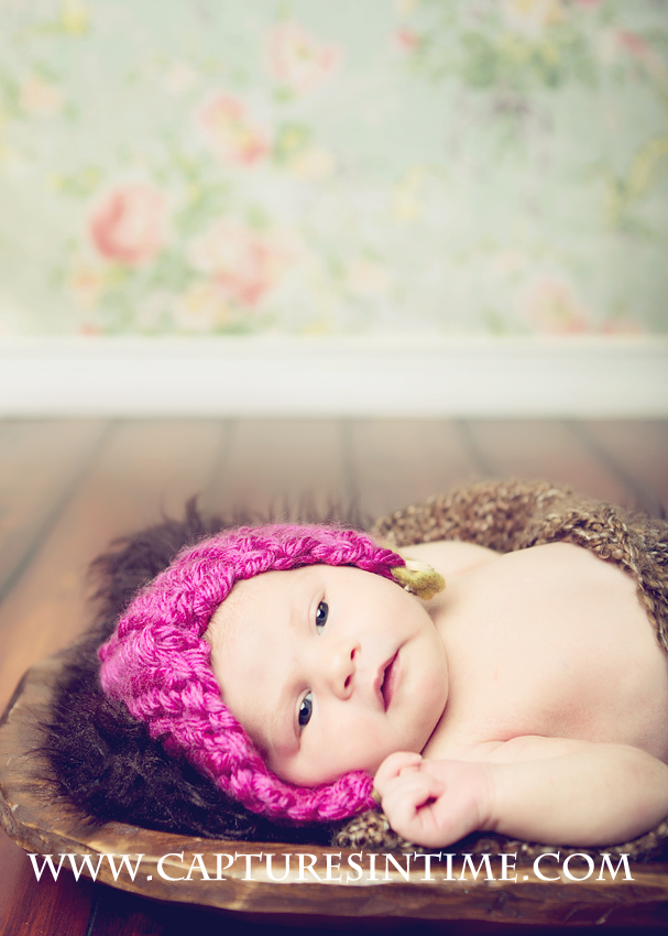 Florals with newborn and pink hat