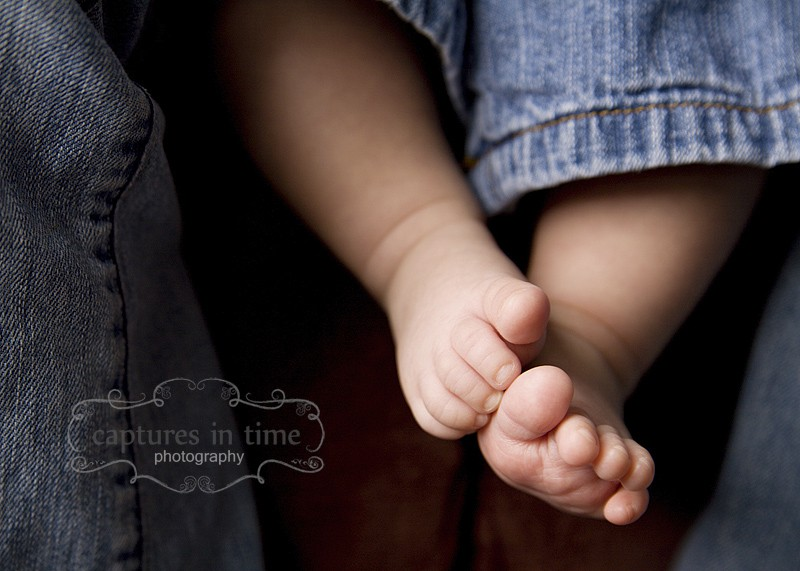baby toes in jeans