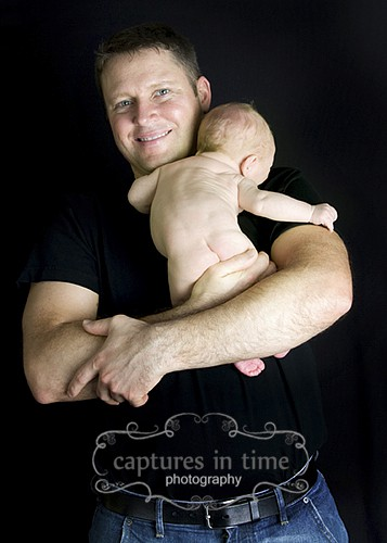 Kansas City Newborn Photography 3 Weeks Old with dad and new baby black backdrop