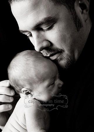 Kansas City Newborn Photographer newborn and dad profile black backdrop
