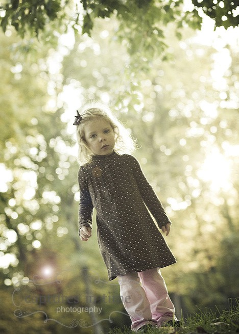 girl in polka dot dress with backlight