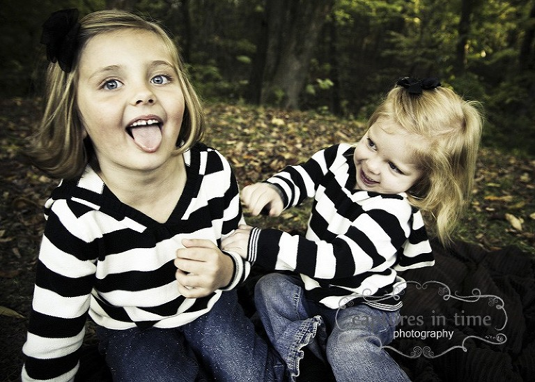 siblings in striped shirts goofing off