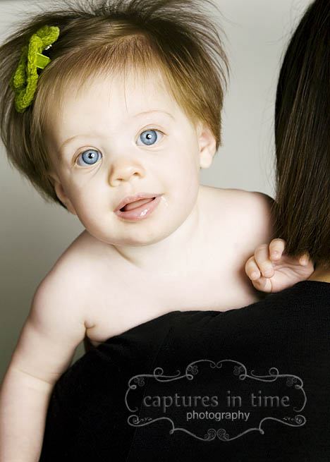 baby with green bow in hair
