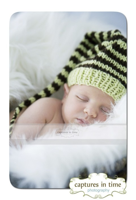 baby in elf hat