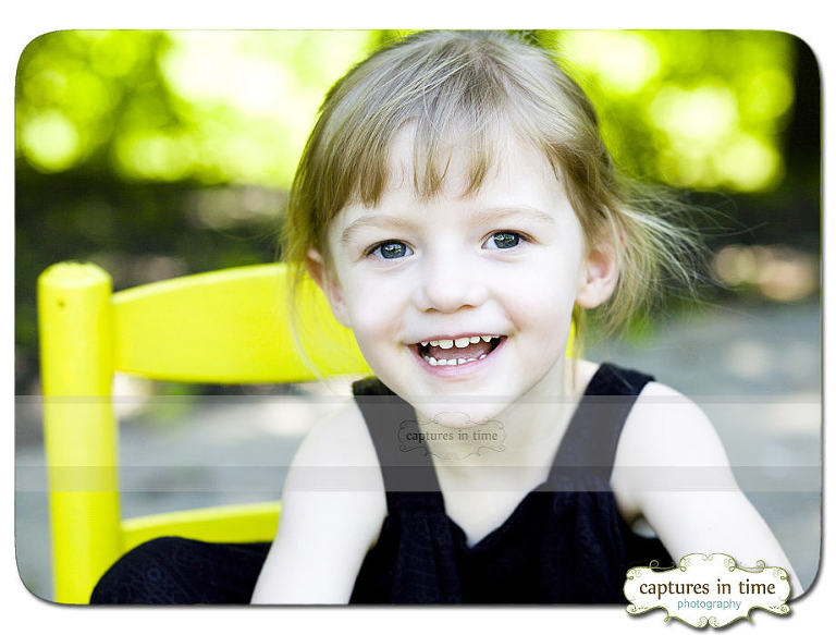 girl outdoors in yellow chair