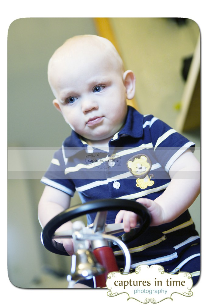 baby on toy firetruck
