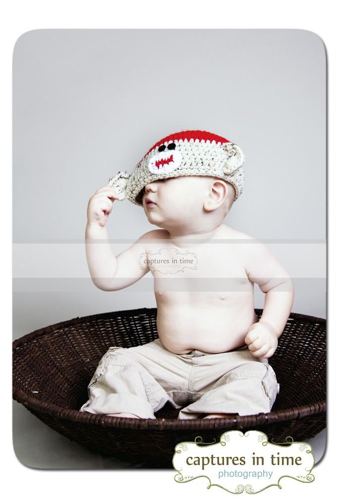 toddler in sock monkey hat