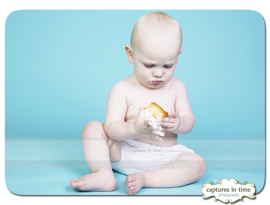 baby eating a cupcake