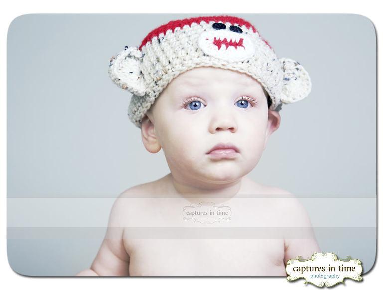 funny face sock monkey hat on baby
