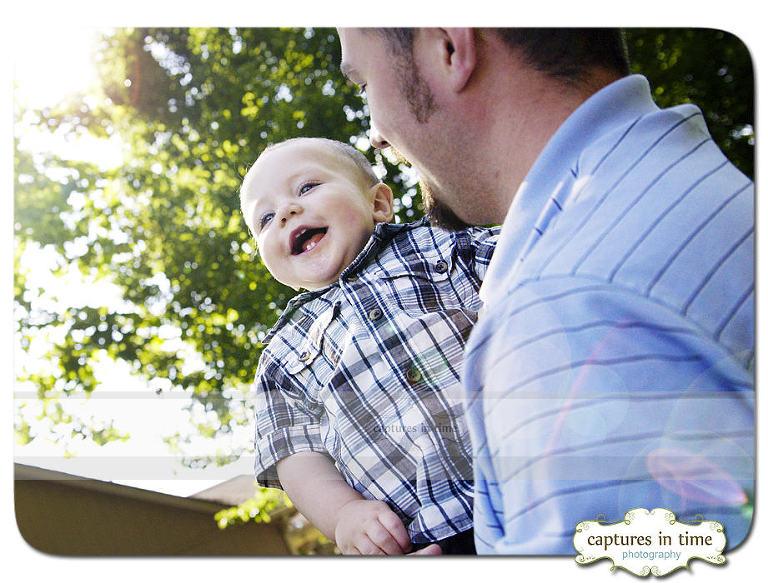 dad holding toddler laughing