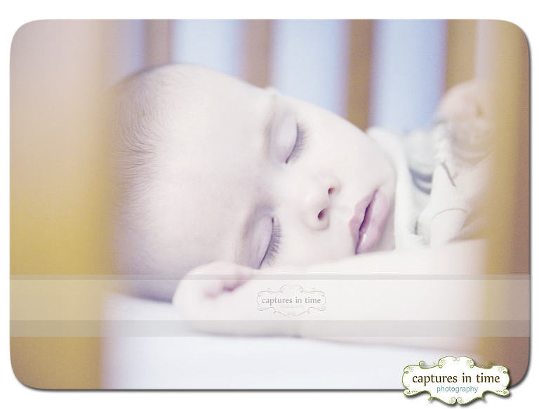 Kansas City Baby Photographer sleeping in crib clients home