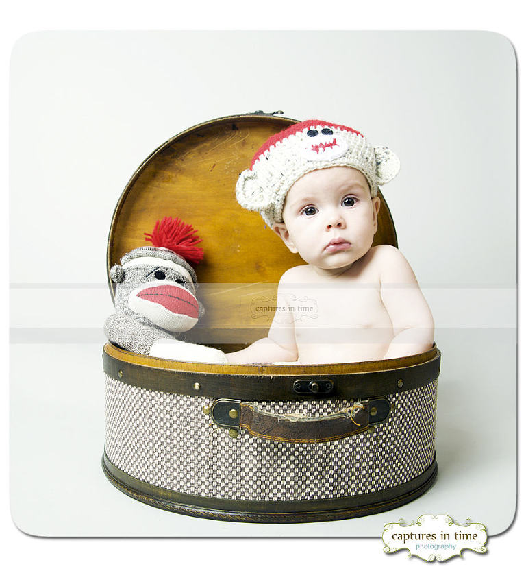 Kansas City Baby Photographer sock monkey baby in basket hat