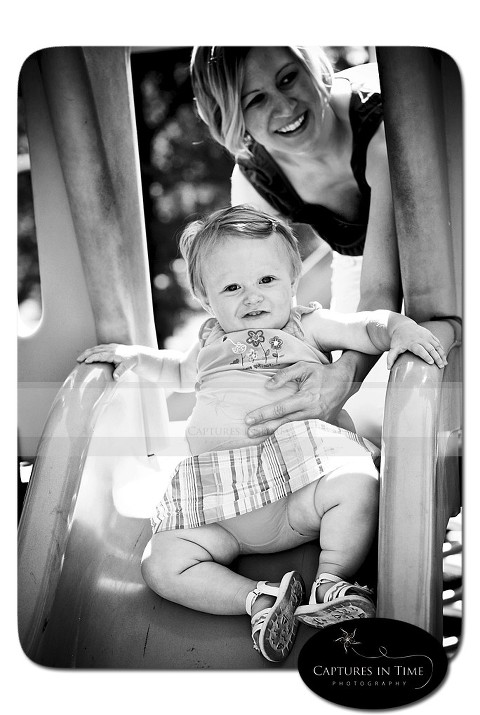 Kansas City Child Photographer baby going down slide with mom English Landing
