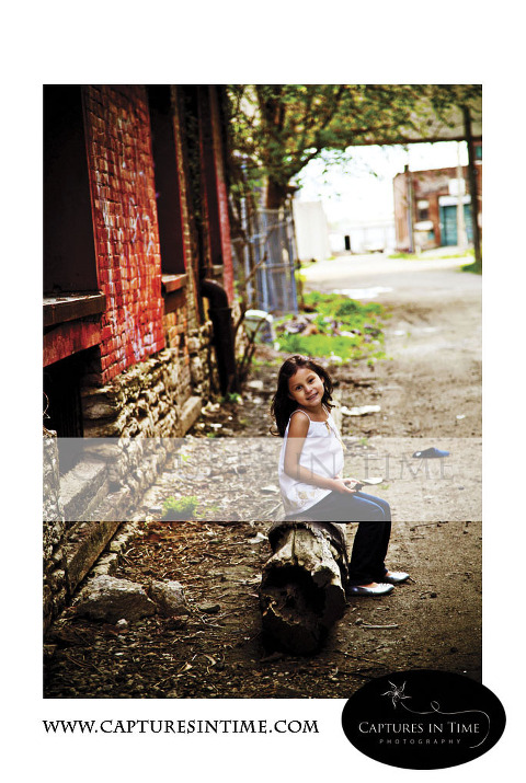 Kansas City Photographer girl sitting on a tree stump in Rivermarket
