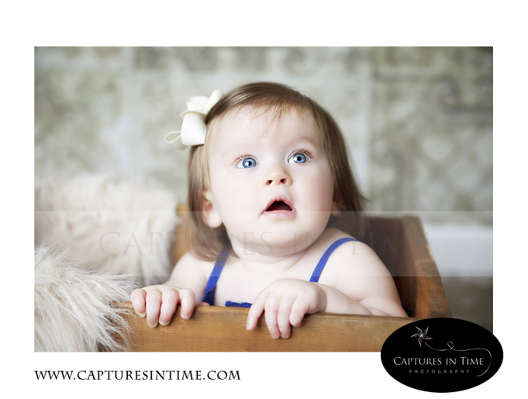 Adorableness Kansas City Photographer one year old in wooden box