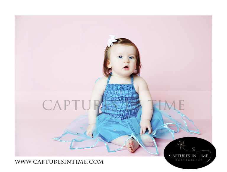 Adorableness Kansas City Photographer one year old on pink backdrop