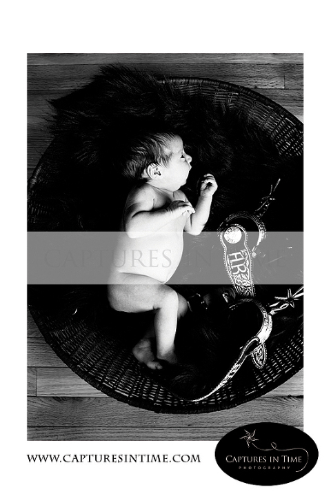 Kansas City Newborn Pics newborn with antique stirrups