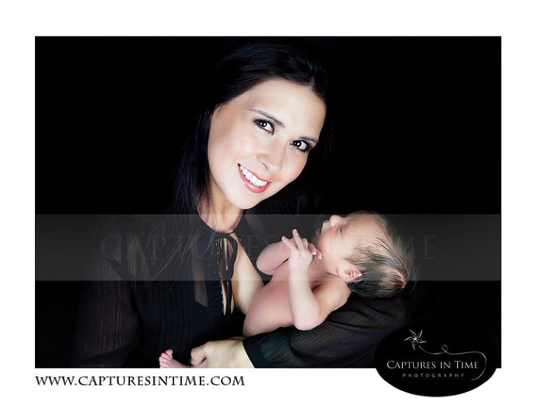 Kansas City Newborn Photography gorgeous mom holds her newborn in all black