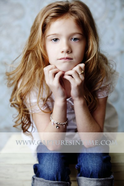 Kansas City Child Photographer girl on blue damask backdrop